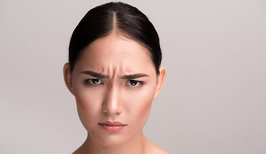 frown corrugator muscle displeasure annoyed