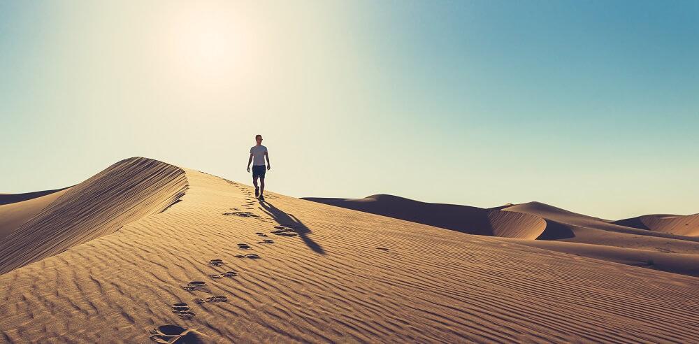 hyperthermia desert hot sun sand dune person walking