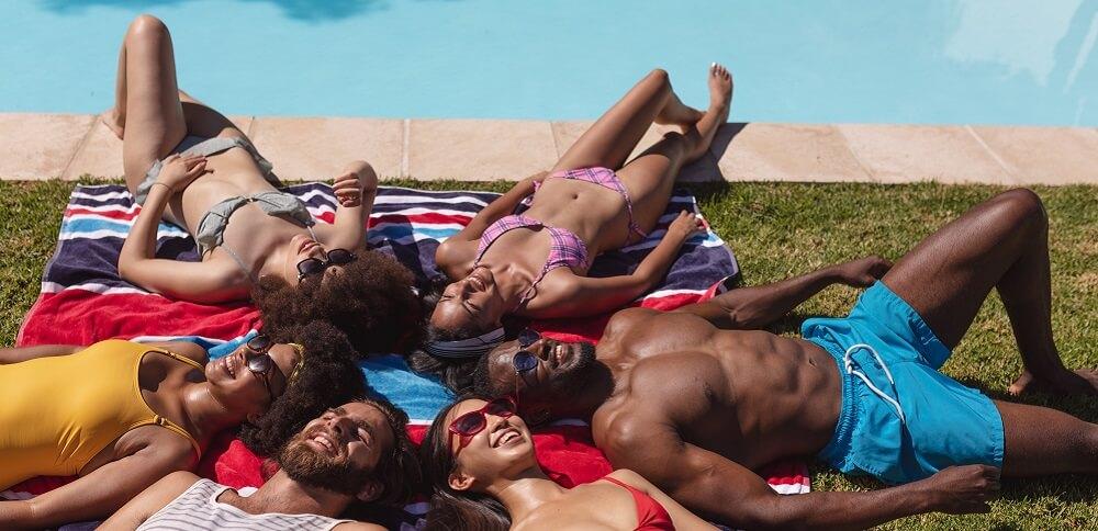 sunbathing UV damage skin cancer sunscreen SCC BCC